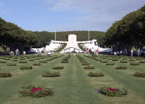 Holiday wreaths adorn the gravestones of service members at the National Memorial Cemetery of the Pacific in Honolulu.