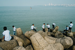 Mumbai, India 2016 (f.d. walker) Tags: asia bombay fuji india mumbai light layers person people men man blue color candidphotography candid clothes colorphotography contrast colors city skyline sky bluesky buildings cityline water street streetphotography sunlight shadow sun sea oceanfront ocean rocks