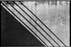 Tmax100M6Summarit_107 (Johnny Martyr) Tags: lines shadows shadow math diagonal concrete texture light divide division four fourlines perfectshadows shadowsofhandrails handrails abstract detail harsh sunlight art found shape design elementsofdesign lineandtexture linesandtextures 35mmfilm film bw blackandwhite blackandwhitelines blackandwhiteshadows blackandwhitemath 4 4lines leica leitz rangefinder kodak leicam6 leitz5cmsummarit 50mm15 5cmsummarit 50mmsummarit leicasummarit summarit15 sharp kodaktmax100 tmax100 kodaktmax kodakhc110 hc110 hc110b homeprocess homeprocessed availablelight existinglight naturallight wall concretewall interesting accidental cornertocorner split rectangle triangle triangles pattern repeat repetition patterns