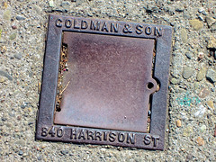 Goldman & Son, San Francisco, CA (Robby Virus) Tags: sanfrancisco california sf ca gerald goldman sewer vent cover metal sidewalk cement concrete pavement