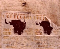 Portugal/Spain (7) (The Spirit of the World) Tags: spain poster bullfight wall brickwall roadtrip 1986 europe sideoftheroad analogphotography film print bulls advertisement