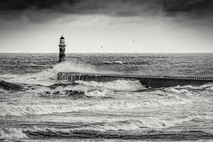 Roker Pier And Lighthouse Mono (robinta) Tags: mono monochrome blackwhite blackandwhite architecture buildings pier lighthouse sunderland roker robintaylorphotography black white contrast texture sky clouds dramatic moody sea seascape waves tide surf ocean pentax ks1 sigma18200mmhsmc historic landmark stone brick sand light shadows