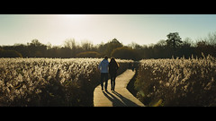 Beginnings (Duncan Birnie) Tags: people cinematic light evening nature reeds couple boardwalk sonnartfe55mmf18