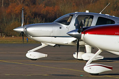 CIRRUS SR22 N53LG, N89NB (BIKEPILOT) Tags: blackbushe eglk airport airfield aerodrome aircraft aeroplane aviation flying hampshire uk greatbritain cirrus sr22t n53lg cirrussr22 n89nb grey blue white