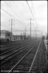 (david sine) Tags: camera blackandwhite film station train 35mm newjersey kodak trix linden traintracks tracks nj rangefinder things wires trainstation stuff russian fed3 scannednegative crappyoverpricedcondos