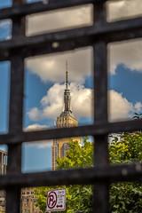 Empire State Building (ronnymariano) Tags: city nyc blue summer sky ny newyork tower skyline fence us unitedstates manhattan streetphotography landmark depthoffield empirestatebuilding gotham nycity 2015 nyclandmark