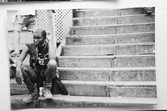 My french is improving... (-PopJuiceFilm-) Tags: gay white black art film beer monochrome lady stairs 35mm sitting boots pentax k1000 bald some artsy sittin skatopia