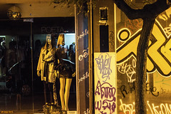 The line 2. (df-stop.) Tags: street urban reflection tree shop night canon closed dummies grafitti legs display rich poor greece thessaloniki split drainpipe timeless halved theline makedonia μακεδονια macedoniagreece eurocrisis dfstop