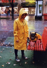 Raincoats (ture360) Tags: olympus tampere fujicolorsuperiaxtra400 streetphotography dog raincoat girl analog film filmcamera 2016 finland yellow red hmeenkatu epsonv200 scanned rain