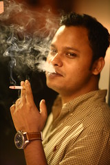 Smoke & Smile (N A Y E E M) Tags: johnny bartender friend candid portrait smoke cigarette street dampara chittagong bangladesh sooc raw unedited untouched unposed night availablelight smile