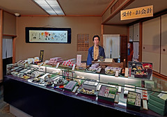 Japan 2015. Kyoto. The candies seller. (Margnac) Tags: margnac jeanpaul photographervisualartist kyoto seller portrait manshopping japan japon