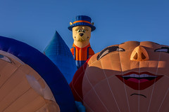 Balloon Fiesta 2016 | Little Dog In the Middle | MorningAscension, 06:44AM (Facundity) Tags: aibf albuquerqueinternationalballoonfiesta balloonfiestapark balloonfiesta2016 albuquerque newmexico hotairballoons morningascension whimsy colorful specialshapesrodeo specialshapes outdoorphotography outdoors canon5dmkiv ef70mm200mmf4lisusm canon