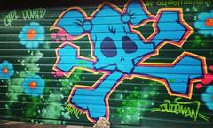 Girl Power! #graffiti #streetart #girlpower #grrlpower #skull #shootingwithJan (Georgie_grrl) Tags: instagramapp square squareformat iphoneography uploaded:by=instagram mayfair dudeman graffiti streetart skull pigtails girlpower flowers garage alleyway