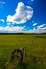Big Country (stevenbulman44) Tags: blue summer sky cloud field grass canon fence landscape post outdoor barbedwire ranchland bigcountry 1740f40l