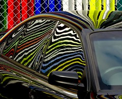 Paint Job (phunnyfotos) Tags: distortion color colour reflection car fence reflections nikon clayton stripes australia melbourne victoria vic carpark monash 3168 wirefence hff pc3168 p600 austpctagged nikoncoolpixp600 cyclonewirefence monashmedicalcentre phunnyfotos monashchildrenshospital