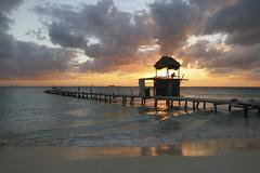 Sunset (withUibelong) Tags: ocean sunset sea silhouette mexico island pier hut islamujeres