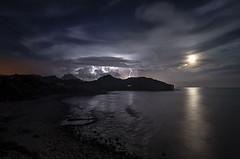 duelo de luz (PerricoMalo) Tags: sea costa moon seascape storm beach night clouds noche coast mar rocks ray playa luna nubes tormenta rayo thunder rocas trueno