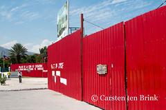 Port-au-Prince Red (10b travelling) Tags: park red monument wall fence island haiti earthquake capital national caribbean siding americas champsdemars corrugated hispaniola haitian 2014 portauprince hati tenbrink carstentenbrink chanmas iptcbasic 10btravelling