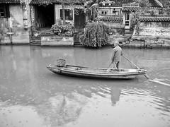 man rowing his boat (Ket Lim) Tags: shanghai china travels blackandwhite asia trips monochrome nanjing suzhou pudong bund canal xitang hangzhou travel streets