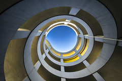 spiral to heaven (Blende1.8) Tags: carpark parkhaus spiral spirale heaven sky upwards nachoben architecture architektur kurven rund rundung rotunde gedreht aufwrts wideangle voigtlnder voigtlaender 10mm heliarhyperwide city urban color colours blue yellow blau gelb sony alpha ilce7m2 a7m2 a7ii carstenheyer wuppertal