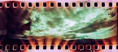 Superior clouds (kevin dooley) Tags: lomographysprocketrocket sprocketrocket sprockets lomo film panorama pan crossprocessed xpro az arizona