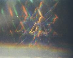 """I mean half of me says the bastard owes me."" (H o l l y.) Tags: lomography kodak trimlite instamatic light rainbow girl portrait weird lens filter refraction trip retro indie vintage"