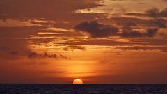At sunset (cernicb) Tags: sun sunset sky clouds sea ocean waves red orange landscape dusk evening horizon