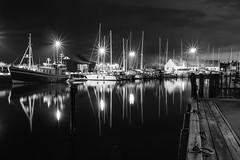 Sleeping boats (krkojzla) Tags: boats sea water night long longexposure olympusem5 panasoniclumix20mmf17 bw blackandwhite monochromatic monochrome contrast lights starlight reflection sweden helsingborg