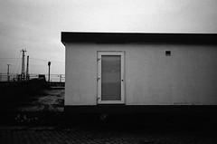 door 4 (Some More Sundays) Tags: blackwhite schwarzweiss analog analogue 35mm filmphotography push sureal silence ilfordhp5 rodinal olympusxa2