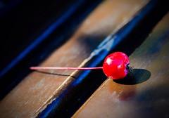 Berry on a bench (vinnie saxon) Tags: berry bench closeup macro fruit stilllife nature urban bokeh nikoniste nikon d600 red
