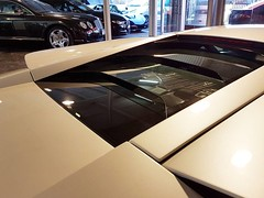 """What have we just bought?? #pearl #pearlwhite #supercar #batman #wings #v12 #supercar #insane #investment #lambo #f1 #bull #fabcar #perthisok #showroom #merchantsofhighoctane #drivesomethingdifferent • <a style=""""font-size:0.8em;"""" href=""""http://www.flickr.com/photos/42053293@N04/31186825962/"""" target=""""_blank"""">View on Flickr</a>"""