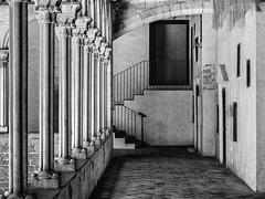 The Cloister (derek.dpr) Tags: barcelona spain espana pedralbes monestir monestirdepedralbes cloister architecture architectural arches corridor bw black bianco nero noir monochrome mono olympus omd em10