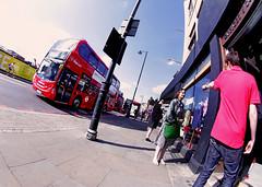 The Accusation (kirstiecat) Tags: london england europe gb greatbritain uk unitedkingdom strangers street canon argument accusation disagreement fisheyelens bus people