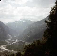 img180 (foundin_a_attic) Tags: switzerland july 1975 river stream hills mountians ice snow peaks view green clouds myst swiss mountain