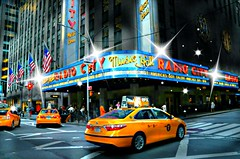 Radio City Blitz (floralgal) Tags: nyc newyorkcity manhattan taxi broadway entertainment timessquare colorfullights excitement radiocitymusichall newyorkcityatnight midtownmanhattan americasgottalent timessquarenewyorkcity homeoftherockettes newyorkcityexcitement entertainmentcapitalofnewyork