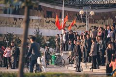 Locals waiting eagerly for the parade (reubenteo) Tags: city red tourism war asia fireworks military korea parade communism celebration kimjongil vip metropolis comrade socialism tanks workersparty northkorea pyongyang 70thanniversary dprk kimilsung kimjongun