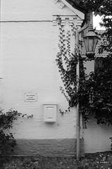 Kein Garnichts / No anything (n0core) Tags: parkplatz fahrrad abstellplatz parkinglot bike schild verbot wyk fhr garnichts no anything bicycle platz analog laterne leuchte efeu bw box briefkasten mailbox canon 35mm 135 f1 film filmfilmforever gebude grain korn haus lomography lomo orwo ostfilm panchromatic n74 n74plus urban ziegel