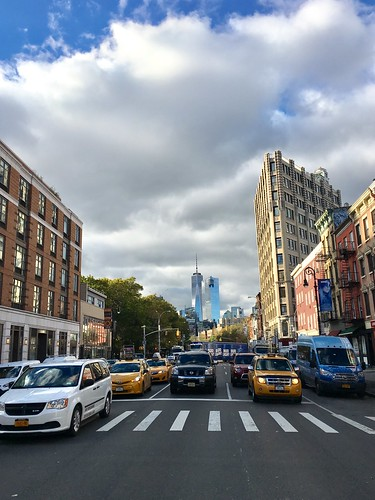 Crossing 6th Avenue with clouds and Freedom Tower