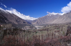 View over the Hunza valley from a hotel room in Karimabad, northern Pakistan (omnia2070) Tags: pakistan karakoram mountains highway karimabad hunza valley world roof hotel room balcony view vista field orchard ridge snow cloud tree