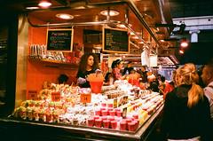 Fruit salad, coconut and  fruit juice (srgpicker) Tags: 35mm analog barcelona boqueria expired film fotosistema iso100 mercado mercat mjuii olympus zumos macedonia fruitsalad coconut coco mjuii food market fruits fruta fruites analogue parada bcn curlyhair people stall girl woman colourful colorful rizos