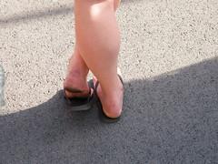 Girl's filthy soles in flip flops (Face11) Tags: tough soles callouses barefoot heels calloused rough flip flops dangle female calves