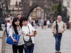 Two women (memfisnet) Tags: czechrepublic prague travel travelphoto street streetfoto bridge women olympus olympusem5