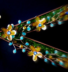pointing the way to . . . . (Winter Ghosts) Tags: letterv love macromondays arrow flowers art lightcatcher wire enamel colours green yellow gold turquoise