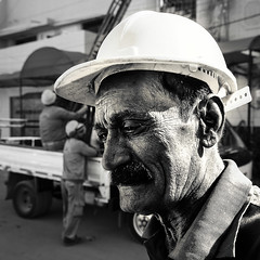 Electrical worker on our street (Fortunes2011. trying street photography) Tags: street candid portrait face man male hardhat hat mustache bw blackandwhite blackwhite monochrome 11 square flickrheroes