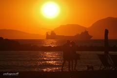 A daily sunset (andreaprinelliphoto) Tags: andreaprinelliphoto andreaprinelli prinelli sunset tramonto estate mare marinadimassa toscana nave silhouette dog cane canon crepuscolo agosto passeggio passeggiata