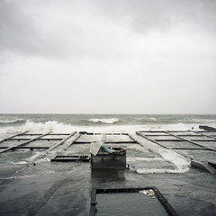 remnants of the past (Tom Kondrat) Tags: taiwan analogue film mamiya6 mediumformat 120 6x6 kodakportra160 before typhoon typhoonblues tomkondrat calmbeforethestorm sea box chess waves malakas