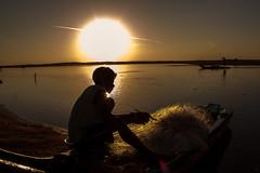 Ritual (BALAJI SEETHARAMAN) Tags: morning light people sun lake man reflection silhouette sunrise work lens boat fishing fisherman silence flare nets chennai cwc pondi puduchery nammachennai alamparai chennaiweekendclickers cwc478 balajiseetharaman
