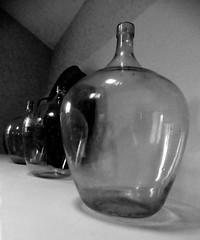 Demijohns (leavesandpuddles) Tags: glassware glass demijohns antique monochrome winebottles blackandwhite bw objets minimal interiordesign schwarzundweiss biancoenero blancetnoir blancoynegro