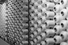 Bobbins (mecenas zielon) Tags: blackandwhite bw italy milan 50mm perspective production textiles bobbins manufacturing 2015 allforfun itma wojciechzielenkiewicz