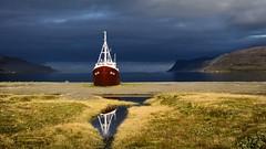 Beached (loveexploring) Tags: reflection beach sunshine landscape boat iceland ship beached fjord darkcloud westfjords patreksfjördur
